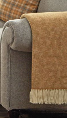 A stylish Parquet patterned throw made from Lambswool. One of our most minimal yet popular throw designs, this small scale weave features six sophisticated colourways, including Gold, Camel and Aqua. Florence Knoll, Camel, Minimalism, Home Improvement, Ottoman, Weaving, Blanket, Stylish, Moon