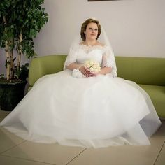 This modest plus size wedding dress has short sleeves.  The illusion neckline covers the bust area. Elegant plus size wedding dresses like this can be recreated by our company with any change a brides wants. You can customize one of our bridal designs, use a picture you have as inspiration for a custom wedding dress or we can even make a less expensive #replica of a haute couture wedding gown for you.  Get pricing on custom plus size wedding dresses when you email us from our site at…
