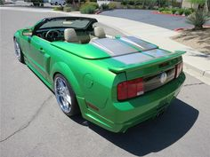 Lot #70 2005 #FORD #MUSTANG #GT #CUSTOM #CONVERTIBLE Highly customized Mustang built for the #LasVegas #SEMA show by Street Scene Equipment. Featuring a wild House of Kolors Candy Apple Pearl Green paint job done with attention to detail, this car turns heads. #BarrettJackson #auto #auction #car #cars #forsale