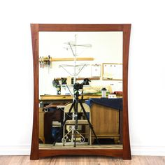 This mirror is featured in a solid wood with a glossy finish. This contemporary style wall mirror has beveled edges and a curved frame. A stylish addition to any room! #contemporary #decor #mirror #sandiegovintage #vintagefurniture