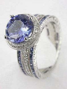 Three ring wedding set from Beverley K Collection includes a sapphire & diamond engagement ring w/ two sapphire eternity bands.