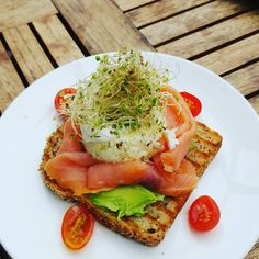 [I ATE] avocado toast smoked salmon tomatoes alfalfa sprouts poached egg and creme sprinkled with dill