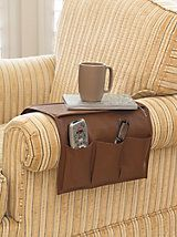 Sofa/Armchair Organizer - Chair Caddy: Make something like this, but be sure it is long enough to tuck under the cushion so the weight of the remotes, etc won't cause it to slide right off.