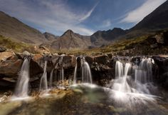 FAIRY Pool, The Highlands, Scotland -- Deep in the Isle of Skye is a collection of crystal clear pools connected by miniature waterfalls that are the perfect size for a dip, if you don't mind freezing your fairies off. Places To Travel, Places To See, Places In Scotland, Fairy Pools, Travel Ads, Beautiful Places In The World, Amazing Places, Wonderful Places, British Isles