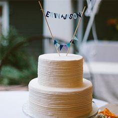 A charming North Carolina wedding with a blue color scheme, scrabble details, lawn games, and a bride in Toms!