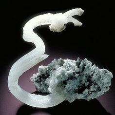 Gypsum.  Chemical formula:  CaSO4·2H2O.  A sulfate mineral.