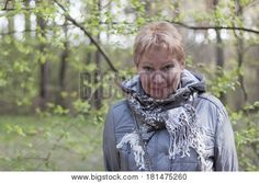 Mature Woman In The Spring Forest