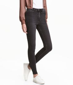 Black washed out. Jeans in washed superstretch denim with a high waist and zip fly with button. Mock pockets at front, regular pockets at back, and