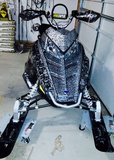 2014 Polaris Pro 800 RMK with Skullz & Black Snakeskin over silver base coat with high class clear coat. Turned out BAD-ASS!!  Visit us at www.facebook.com/Intermountainhydrographics Or Contact us direct at 801-710-3114.