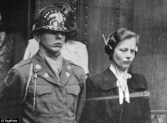 Dr Herta Oberheuser, a physician who worked at Ravenbruck concentration camp, is flanked by a US guard while on trial for war crimes including injecting prisoners with petrol and deliberately inflicting wounds for experiments.