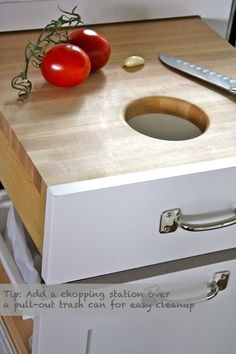 Install a Hidden Cutting Board:  If you've love the functionality of a kitchen island but don't have room for one, consider installing a pull-out butcher-block chopping station right over your trash can. You can chop straight on the cutting board and easily whip discards into the trash can.