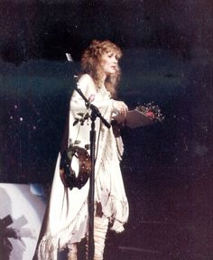 A print, purchased at a garage sale, of Stevie Nicks performing