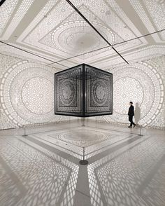 Intersections | Pakistani-American artist Anila Quayyum Agha uses light and cast shadow to transform a place that alludes to Islamic sacred spaces dense with geometric ornamentation and pattern. Within Intersections no clear boundary or separation exists; our moving bodies change the nature of the pattern as we walk freely through its dense silhouette. by ezachung