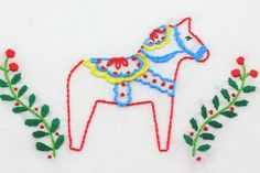 It's not all black and white! Embellish your tablecloths, napkins, pillows, and more with the cute big B's Scandinavian Christmas embroidery patterns, or draw your own dala horse.