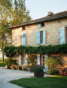 MONTAUBAN, FRANCE | Nestled in the southwestern French countryside, the enchanting 50-acre farm La Castellane has been thoughtfully transformed by its longtime owner, designer Kathryn M. Ireland. Shutters painted sky-blue enliven the renovated main dwelling, built around 1850. Inside, rooms exude bohemian chic.