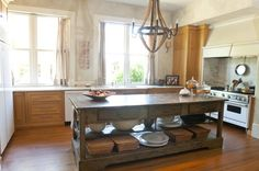 The 8-foot-by-3-foot kitchen island was created by a man in the south of France after Marie found a small version of the island at Scott Antique Markets.