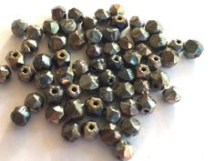 Vintage beads (50) Spacers black gunmetal gray silver bronze faceted German 5mm (50) by a2zDesigns on Etsy