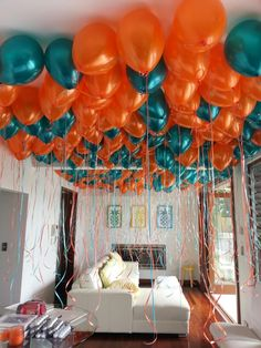 Loose Balloons Covering A Marquee Roof In Teal And Orange