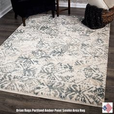A modern muse of style, Orian Rugs Amber Point Area Rug in Smoke displays an abstract art inspired motif cast in a versatile palette of taupe, gray, beige and silver hues. Crafted in the U.S.A. of premium...