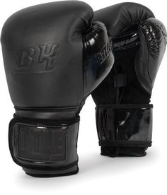 """TITLE BLACK® Bag Gloves by Title Boxing. $199.99. The TITLE BLACK equipment line takes you to the edge with precision """"king cut"""" double-ply full grain leathers, brilliant and luxurious patent leathers and extra deep pile suede leathers that complement each other in a rich compilation of premier quality, clout and exclusive membership. These exclusive punching bag gloves are crafted with a technical assemblage of almost 2"""" of hi-impact contact foam and lo-impact fist protecti..."""