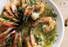 Rather than the customary sautéeing, this scampi is actually roasted in butter spiked with lemon and herbs as well as garlic, then served piping hot with crusty bread.