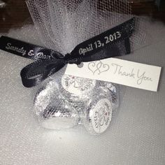 Wedding party favors...This would be cute with red and black ribbon.