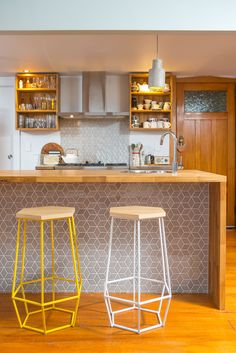 Kitchen 642. Sally Steer Design Ltd. Wellington, New Zealand. Fingerjointed American Oak benchtop with waterfall ends. Feature tile island back panel.