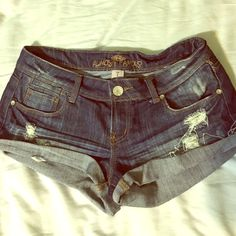 🎀Like New🎀 Almost Famous jean shorts Like New Almost famous Jean shorts. Size 7   Dark blue, distressed under pockets. On back pockets is gold sequence line across, and silver stitching. Almost Famous Shorts Jean Shorts