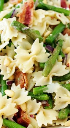 Asparagus & Bacon Pasta Salad ~ Skinny baby asparagus and a plentiful amount of bacon are married in this mini bowtie pasta salad dressed in a lemony Caesar-inspired dressing with shaved Parmesan cheese, red onion and pine nuts.