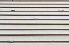 Garage doors garage and window on pinterest for Hail damage vinyl siding