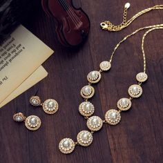 Neoglory Rhinestone 14K Gold Plated Ethnic Jewelry Sets Wedding Necklace and Earrings Leaf Style for Women Wholesale 20...