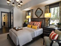 HGTV Dream House, Lake Tahoe: The Master Bedroom No detail is left unfinished in this luxurious master bedroom, from the industrial-style lighting to the leather-upholstered bed to the patterned accents. Interior designer Linda Woodrum chose full-sized dresses in lieu of traditional nightstands to perfectly fit under the windows on either side of the bed.