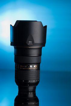 24-70mm Nikkor Product Shoot: a Blue Gelled Flash at 105mm 1/4 power at 9 oclock at same level and softbox at 3 o'clock of camera.