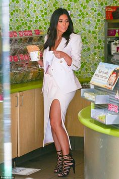 Yum Yum: The 33-year-old showed off her tanned legs as she chose which toppings to have on...