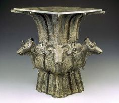 Four Sheep Wine Vessel/Square vessel (fang zun) with four rams, from Shang Dynasty (1300–1046 BC).   It is listed as National Masterpiece. Exquisitely made, 4 sheep in relief on the 4 sides.The legs of the sheep reach its base.Its edges are decorative engravings and its shoulders are ornamented with 4 dragons.The sheep and dragons are all over covered with beautiful pattern.It is not only an artistic bronze work but a rarity as well.