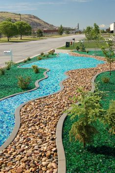 i think this colored glass mulch is so cool garden ideas from landscaping pebbles, image source: pinterest.com