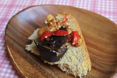 A vegan recipe for Israeli Eggplant and Pepper Salad, made with fried eggplant, red bell peppers, and a tomato garlic sauce.