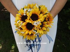 I REALLY like these flowers: sunflowers, softness of white, with the wispy blue ribbon. I do NOT like the round style bouquet.