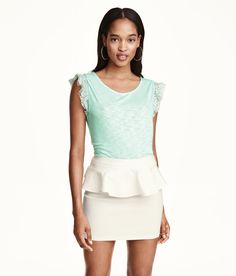 Short mint green top with slight sheen, back V-neck, and lace ruffled sleeves. | H&M Pastels