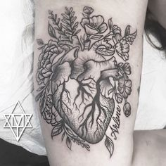 Stipple anatomical heart with flowers tattoo by Momma Tomma