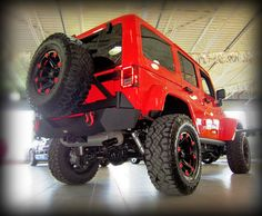 """SOLD! Modified 2013 Jeep Wrangler Unlimited in Rock Lobster!!   Mod's include:   -4"""" zone lift kit  -Fox shocks -Smittybilt XRC modular bumpers, bumper end with fog lights, rear bumper with swing out arm, pro8 winch and windshield light brackets - Front and rear bumper shackles - Ballistic 814 rims with custom paint - 315/70/17 Goodyear Duratrac tires - Mopar black fuel door & tail light covers - Black exhaust tips - Rigid 2 inch flood lights"""