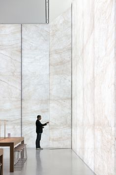 Apple Store, Sands Cotai Central, Macau - interior retail space with glass-stone composite curtain wall with person. Image Courtesy of Nigel Young, Foster + Partners Macau, The Fosters, Apple Store, Glass Curtain Wall, Lobby Interior, Interior Design, Stone Interior, Foster Partners, Lobby Design