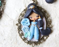 Browse unique items from ZingaraCreativa on Etsy, a global marketplace of handmade, vintage and creative goods. Polymer Clay Disney, Cute Polymer Clay, Polymer Clay Dolls, Polymer Clay Miniatures, Polymer Clay Necklace, Polymer Clay Crafts, Clay Keychain, Homemade Art, Clay Figures