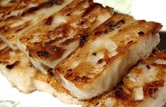 Turnip Cake:  3 1/4 cups rice flour  8 dried shiitake mushrooms  2 ounces dried shrimp  6 ounces Chinese bacon (lop yok) or Chinese sausage  1 large Chinese white turnip, about 2 pounds  3 tablespoons peanut or vegetable oil  2 teaspoons Shaoxing rice cooking wine  2 teaspoons dark soy sauce  1 teaspoon salt