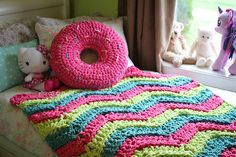 This is a PDF crochet pattern for a Bulky & Quick Donut pillow. This is a fun plush throw pillow that's extra yummy! It works up super quick using a 16mm crochet hook with 2 strands of blanket yarn. 1~300 gram ball is needed for the icing and an additional ball for the bottom of donut. Scraps can be used in various colours for sprinkles. The donut is stuffed with polyester fill. The stitches are thick and tight to hold that stuffing in!