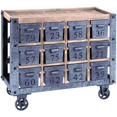 "Wood and metal cart with twelve numbered drawers. Product: CartConstruction Material: Wood and metalColor: Natural and grayFeatures:  Charming designEach of the 12 drawers are individually numbered and offer deep storage space Four wheels for easy mobilityDimensions: 32"" H x 37"" W x 16"" D"