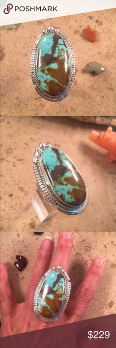 Navajo Pilot Mountain Turquoise Ring Adjustable This piece is made of Sterling Silver and Pilot Mountain Turquoise. The length of this ring is 2 inches long and 1 1/4 inches wide. This ring is adjustable starting at a size 9 up to a 11. This piece is signed by the artist and Stamped Sterling. Jewelry Rings