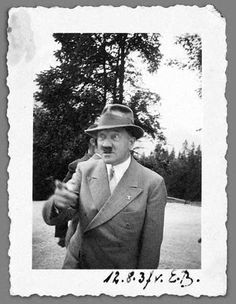 "This is an original, deckle-edged, private snapshot of Adolf Hitler, labelled in ink as being taken by ""E.B."" (Eva Braun) on August 12, 1937 as he wags an admonishing finger at somebody out of sight. It is annotated on the front and back. The picture was given by Braun to Lina Braunmüller, a local hospital worker, and was in the Braunmüller estate."