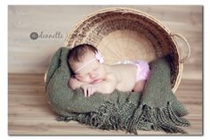 newborn with basket laying down - perfect when you can't get them inside :)