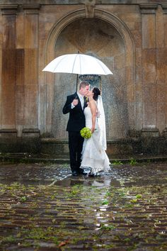 Wedding Rain picture at the cultural gardens in Cleveland Ohio.  Back lit couple on rainy day.  This is one of my clients favorite picture by Dennis Crider Photography.  Wedding Reception was at the Hyatt Arcade in Cleveland.
